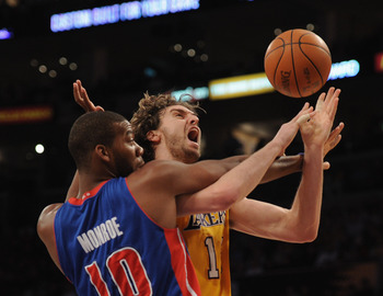 Greg Monroe getting physical with Pau Gasol of the Lakers.