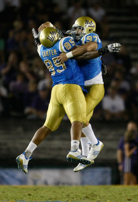 PASADENA, CA - SEPTEMBER 19:  David Carter #85 and Damien Holmes #97 of the UCLA Bruins celebrate after Holmes recorded a sack against the Kansas State Wildcats late in the fourth quarter at the Rose Bowl on September 19, 2009 in Pasadena, California. UCL