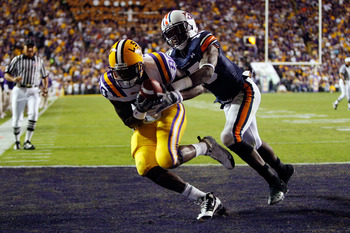 BATON ROUGE, LA - OCTOBER 24:  Terrance Toliver #80 of the Louisiana State University Tigers catches a touchdown pass over Neiko Thorpe #15 of the Auburn Tigers at Tiger Stadium on October 24, 2009 in Baton Rouge, Louisiana.  (Photo by Chris Graythen/Gett