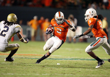 FORT LAUDERDALE, FL - SEPTEMBER 17:  Running back Graig Cooper #2 of the Miami Hurricanes looks to avoid being brought down by cornerback Mario Butler #2 of the Georgia Tech Yellow Jackets at Land Shark Stadium on September 17, 2009 in Fort Lauderdale, Fl