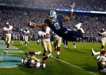 CHAPEL HILL, NC - OCTOBER 22:  Greg Little #8 of the North Carolina Tar Heels dives past Florida State Seminole defenders Patrick Robinson #21, Nigel Carr #12 and Ochuko Jenije #15 for a first quarter touchdown at Kenan Stadium on October 22, 2009 in Chap