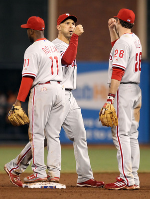 SAN FRANCISCO - OCTOBER 21:  Jimmy Rollins #11, Raul Ibanez #29, and Chase Utley #26 of the Philadelphia Phillies celebrate defeating the San Francisco Giants 4-2 in Game Five of the NLCS during the 2010 MLB Playoffs at AT&T Park on October 21, 2010 in Sa