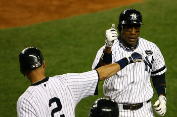 NEW YORK - OCTOBER 20:  Curtis Granderson #14 of the New York Yankees celebrates with Derek Jeter #2 after Granderson hit a solo home run in the bottom of the eighth inning against the Texas Rangers in Game Five of the ALCS during the 2010 MLB Playoffs at