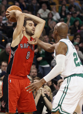 BOSTON, MA - JANUARY 07:  Jose Calderon #8 of the Toronto Raptors looks to pass as Ray Allen #20 of the Boston Celtics defends on January 7, 2011 at the TD Garden in Boston, Massachusetts. The Celtics defeated the Raptors 122-102. NOTE TO USER: User expre