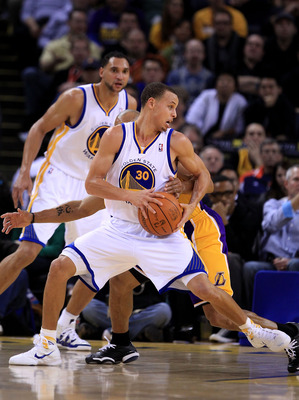 OAKLAND, CA - JANUARY 12:  Stephen Curry #30 of the Golden State Warriors in action against the Los Angeles Lakers at Oracle Arena on January 12, 2011 in Oakland, California. NOTE TO USER: User expressly acknowledges and agrees that, by downloading and or
