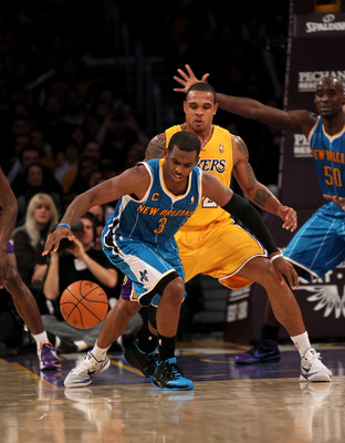 LOS ANGELES, CA - JANUARY 7:  Chris Paul #3 of the New Orleans Hornets controls the ball in front of Shannon Brown #12 of the Los Angeles Lakers at Staples Center on January 7, 2011 in Los Angeles, California.  The Lakers won 101-97.  NOTE TO USER: User e