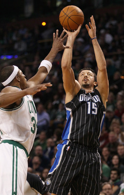 BOSTON, MA - JANUARY 17:   Hedo Turkoglu #15 of the Orlando Magic takes a shot as Paul Pierce #34 of the Boston Celtics defends on January 17, 2011 at the TD Garden in Boston, Massachusetts. The Celtics defeated the Magic 109-106.  NOTE TO USER: User expr