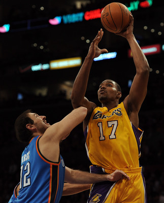 LOS ANGELES, CA - JANUARY 17:  Andew Bynum #17 of the Los Angeles Lakers shoots over Nenad Kristic #12 of the Oklahoma City Thunder at the Staples Center on January 17, 2011 in Los Angeles, California.  (Photo by Harry How/Getty Images)   NOTE TO USER: Us