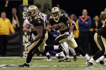 NEW ORLEANS - JANUARY 24:  Tracy Porter #22 of the New Orleans Saints intercepts a pass late in the fourth quarter against the Minnesota Vikings during the NFC Championship Game at the Louisiana Superdome on January 24, 2010 in New Orleans, Louisiana.  (P