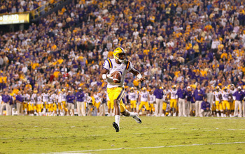 BATON ROUGE, LA - NOVEMBER 20:  Quarterback Jordan Jefferson #9 of the Louisiana State University Tigers rushes out of the pocket against the Ole Miss Rebels at Tiger Stadium on November 20, 2010 in Baton Rouge, Louisiana.  (Photo by Kevin C. Cox/Getty Im