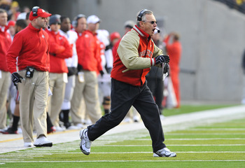 IOWA CITY, IA - NOVEMBER 20: Ohio State Buckeyes head coach Jim Tressel argues a call by officials during play against the University of Iowa Hawkeyes during the first half of play at Kinnick Stadium on November 20, 2010 in Iowa City, Iowa. Ohio State won