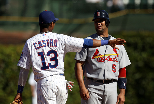 CHICAGO - SEPTEMBER 24: Starlin Castro #13 of the Chicago Cubs and Albert Pujols #5 of the St. Louis Cardinals have a conversation at second base during a pitching change at Wrigley Field on September 24, 2010 in Chicago, Illinois. (Photo by Jonathan Dani