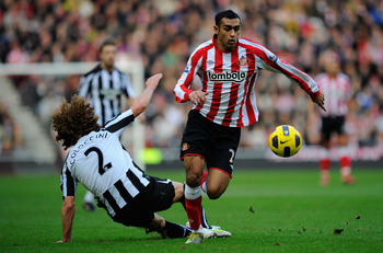 SUNDERLAND, ENGLAND - JANUARY 16:  Newcastle player Fabricio Coloccini fails to stop Ahmed Elmohamady of Sunderland during the Barclays Premier League match between Sunderland and Newcastle United at Stadium of Light on January 16, 2011 in Sunderland, Eng