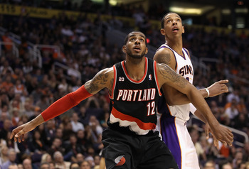 PHOENIX, AZ - JANUARY 14:  LaMarcus Aldridge #12 of the Portland Trail Blazers blocks out Channing Frye #8 of the Phoenix Suns during the NBA game at US Airways Center on January 14, 2011 in Phoenix, Arizona.  The Suns defeated the Trail Blazers 115-111.