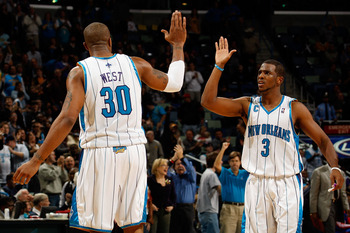 NEW ORLEANS - DECEMBER 16:  Chris Paul #3 and David West #30 of the New Orleans Hornets celebrate during the game against the Detroit Pistons at New Orleans Arena on December 16, 2009 in New Orleans, Louisiana. The Hornets defeated the Pistons 95-87. NOTE