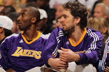 DENVER - NOVEMBER 11:  Kobe Bryant #24 and Pau Gasol #16 of the Los Angeles Lakers look on from the bench against the Denver Nuggets at the Pepsi Center on November 11, 2010 in Denver, Colorado. The Nuggets defeated the Lakers 118-112.  NOTE TO USER: User