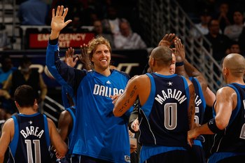 NEW ORLEANS - NOVEMBER 04:  Dirk Nowitzki #41  and Shawn Marion #0 of the Dallas Mavericks celebrates during the game against the New Orleans Hornets at New Orleans Arena on November 4, 2009 in New Orleans, Louisiana.  NOTE TO USER: User expressly acknowl