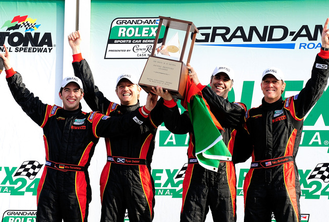 DAYTONA BEACH, FL - JANUARY 31:  Terry Borcheller, Joao Barbosa, Mike Rockenfeller, and Ryan Dalziel, drivers of the #9 Action Express Racing Porsche Riley, display the trophy after winning the DP Class of the Grand-Am Rolex 24 at Daytona held at Daytona