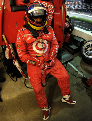 DAYTONA BEACH, FL - JANUARY 30:  Juan Pablo Montoya, driver of the #02 Target/TELMEX BMW Riley awaits his turn to drive during the Grand-Am Rolex 24 at Daytona held at Daytona International Speedway on January 30, 2010 in Daytona Beach, Florida.  (Photo b