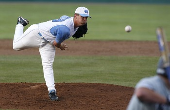 OMAHA, NE - JUNE 21:  Adam Warren #28 of the North Carolina Tar Heels pitches to rightfielder Jared Gayhart #10 of the Rice Owls  during the Tar Heels 7-4 win in Game 13 of the NCAA College World Series at Rosenblatt Stadium on June 21, 2007 in Omaha, Neb