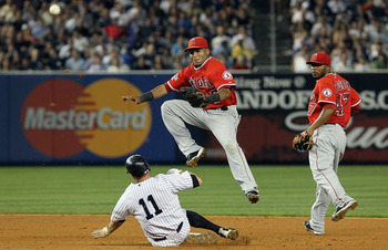 NEW YORK - JULY 20:  Brett Gardner #11 of the New York Yankees is forced out at second base as Erick Aybar #2 of the Los Angeles Angels of Anaheim completes a fifth inning ending double play on July 20, 2010 at Yankee Stadium in the Bronx borough of New Y