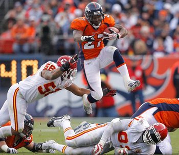 DENVER - NOVEMBER 14:  Running back Knowshon Moreno #27 of the Denver Broncos jumps over a pile of defenders and past linebacker Derrick Johnson #56 of the Kansas City Chiefs during the second quarter at INVESCO Field at Mile High on November 14, 2010 in