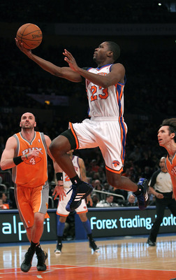 NEW YORK, NY - JANUARY 17:  Toney Douglas #23 of the New York Knicks lays the ball up against the Phoenix Suns at Madison Square Garden on January 17, 2011 in New York City. NOTE TO USER: User expressly acknowledges and agrees that, by downloading and or