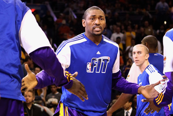 PHOENIX, AZ - JANUARY 05:  Ron Artest #15 of the Los Angeles Lakers is introduced before the NBA game against the Phoenix Suns at US Airways Center on January 5, 2011 in Phoenix, Arizona. The Lakers defeated the Suns 99-95.  NOTE TO USER: User expressly a