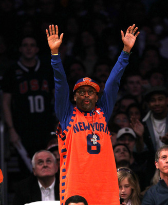 LOS ANGELES, CA - JANUARY 09:  Film maker Spike Lee cheers for the New York Knicks against the Los Angeles Lakers at Staples Center on January 9, 2011 in Los Angeles, California. The Lakers won 109-87.  NOTE TO USER: User expressly acknowledges and agrees