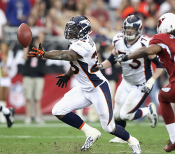 GLENDALE, AZ - DECEMBER 12:  Runningback Correll Buckhalter #28 of the Denver Broncos is unable to catch a pass under pressure from Rashad Johnson #49 of the Arizona Cardinals during the NFL game at the University of Phoenix Stadium on December 12, 2010 i
