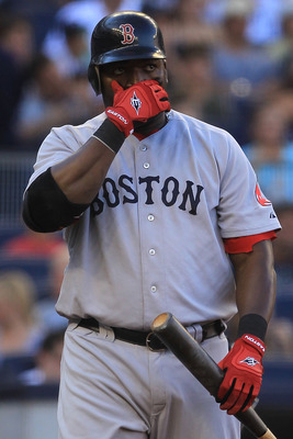 NEW YORK - SEPTEMBER 25: David Ortiz #34 of the Boston Red Sox reacts after a strike against the New York Yankees during their game on September 25, 2010 at Yankee Stadium in the Bronx borough of New York City.  (Photo by Chris McGrath/Getty Images)