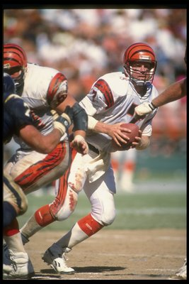 16 Sep 1990: Quarterback Boomer Esiason of the Cincinnati Bengals looks to pass the ball during a game against the San Diego Chargers during a game at Jack Murphy Stadium in San Diego, California. The Bengals won the game, 21-16.