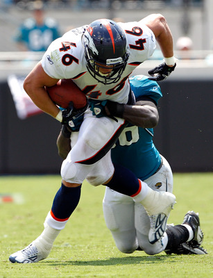 JACKSONVILLE, FL - SEPTEMBER 12:  Spencer Larsen #46 of the Denver Broncos is tackled by Justin Durant #56 of the Jacksonville Jaguars during the NFL season opener game at EverBank Field on September 12, 2010 in Jacksonville, Florida.  (Photo by Sam Green
