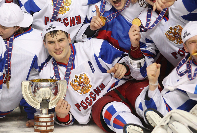 BUFFALO, NY - JANUARY 05: Dmitri Orlov #9 of Russia touches the trophy for winning the 2011 IIHF World U20 Championship Gold medal against Canada after defeating Canada 5-3 at the HSBC Arena on January 5, 2011 in Buffalo, New York.  (Photo by Rick Stewart