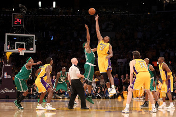 LOS ANGELES, CA - JUNE 17:  Andrew Bynum #17 of the Los Angeles Lakers tips off against Rasheed Wallace #30 of the Boston Celtics in Game Seven of the 2010 NBA Finals at Staples Center on June 17, 2010 in Los Angeles, California.  NOTE TO USER: User expre