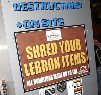 CLEVELAND, OH - DECEMBER 02:  Fans shred there LeBron James gear prior to the Cleveland Cavaliers playing the Miami Heat at Quicken Loans Arena on December 2, 2010 in Cleveland, Ohio. NOTE TO USER: User expressly acknowledges and agrees that, by downloadi