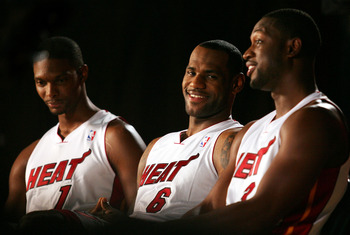 MIAMI - SEPTEMBER 27:  (L-R) Chris Bosh, LeBron James and Dwyane Wade of the Miami Heat answer questions during media day at the Bank United Center on September 27, 2010 in Miami, Florida.  (Photo by Marc Serota/Getty Images)