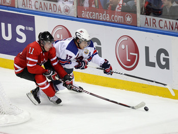 BUFFALO, NY - JANUARY 03:  Ryan Bourque #17  of the United States skates against Casey Cizikas #11 of Canada during the 2011 IIHF World U20 Championship Semi Final game between United States and Canada on January 3, 2011 in Buffalo, New York.  (Photo by R