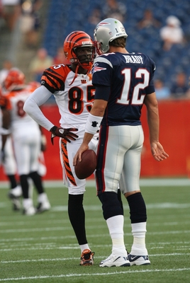 FOXBORO, MA - AUGUST 20:  Chad Ochocinco #85 of the Cincinnati Bengals talks with Tom Brady #12 of the New England Patriots during their preseason game at Gillette Stadium on August 20, 2009 in Foxboro, Massachusetts.  (Photo by Jim Rogash/Getty Images)