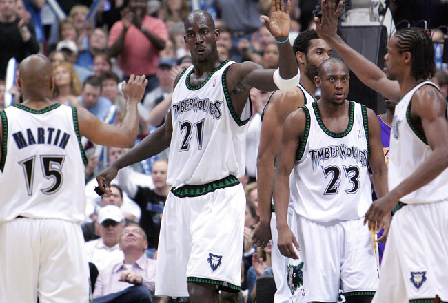 MINNEAPOLIS - MAY 29:  Kevin Garnett #21, Latrell Sprewell #8 and Darrick Martin #15 of the Minnesota Timberwolves celebrate in Game five of the Western Conference Finals against the Los Angeles Lakers during the 2004 NBA Playoffs on May 29, 2004 at Targe