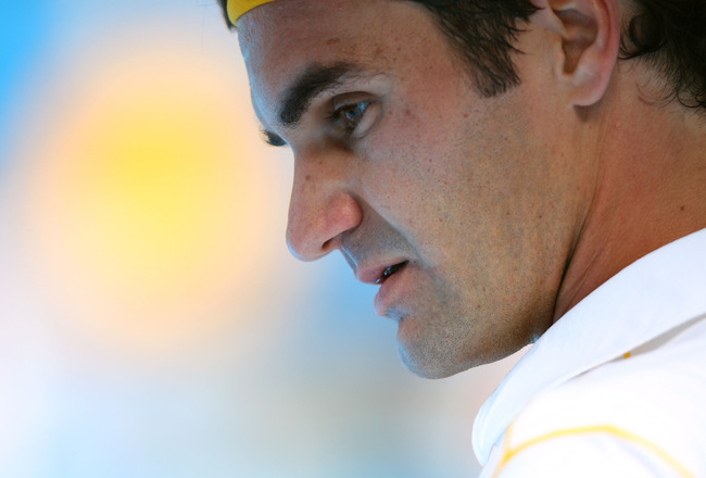 MELBOURNE, AUSTRALIA - JANUARY 17:  Roger Federer of Switzerland looks on between games in his first round match against Lukas Lacko of Slovakia during day one of the 2011 Australian Open at Melbourne Park on January 17, 2011 in Melbourne, Australia.  (Ph