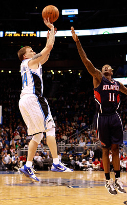 ORLANDO, FL - DECEMBER 06:  Jason Williams #44 of the Orlando Magic attempts a shot over Jamal Crawford #11 of the Atlanta Hawks during the game at Amway Arena on December 6, 2010 in Orlando, Florida. NOTE TO USER: User expressly acknowledges and agrees t