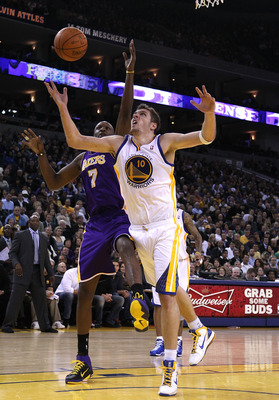 OAKLAND, CA - JANUARY 12:  Lamar Odom #7 of the Los Angeles Lakers and David Lee #10 of the Golden State Warriors go for a rebound at Oracle Arena on January 12, 2011 in Oakland, California. NOTE TO USER: User expressly acknowledges and agrees that, by do
