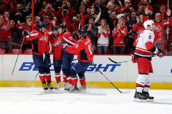 WASHINGTON - NOVEMBER 28:  Alexander Semin #28 of the Washington Capitals celebrates with Alex Ovechkin #8, Mike Green #52 and Nicklas Backstrom #19 after scoring in the first period against the Carolina Hurricanes at the Verizon Center on November 28, 20