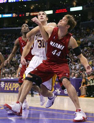 LOS ANGELES - DECEMBER 25:  Chris Mihm #31 of the Los Angeles Lakers and Christian Laettner #44 of the Miami Heat fight for a rebound on December 25, 2004 at Staples Center in Los Angeles, California. The Heat defeated the Lakers in overtime 104-102.  NOT