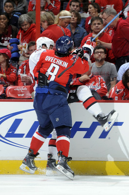 WASHINGTON - OCTOBER 11:  Alex Ovechkin #8 of the Washington Capitals checks Zack Smith #15 of the Ottawa Senators at the Verizon Center on October 11, 2010 in Washington, DC.  (Photo by Greg Fiume/Getty Images)