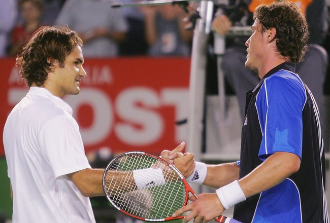 MELBOURNE, AUSTRALIA - JANUARY 27: Marat Safin of Russia (R) shakes the hand of Roger Federer of Switzerland after defeating him during day eleven of the Australian Open Grand Slam, at Melbourne Park January 27, 2005 in Melbourne, Australia. (Photo by Sea