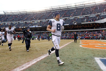 CHICAGO, IL - JANUARY 16:  Quarterback Matt Hasselbeck #8 of the Seattle Seahawks runs off the field after the Seahawks 35-24 defeat to the Chicago Bears in the 2011 NFC divisional playoff game at Soldier Field on January 16, 2011 in Chicago, Illinois.  (