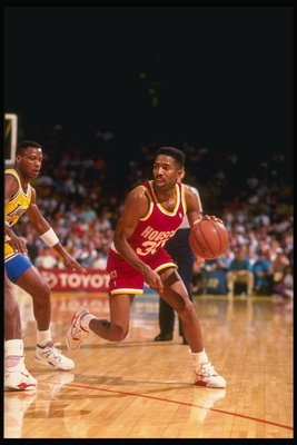 1990-1991:  Guard Kenny Smith of the Houston Rockets tries to keep the ball away from guard Byron Scott of the Los Angeles Lakers (left) during a game at the Great Western Forum in Inglewood, California. Mandatory Credit: Ken Levine  /Allsport