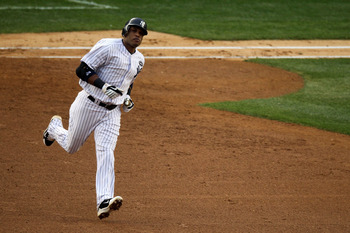 NEW YORK - OCTOBER 20:  Robinson Cano #24 of the New York Yankees rounds the bases after hitting a solo home run in the third inning against the Texas Rangers in Game Five of the ALCS during the 2010 MLB Playoffs at Yankee Stadium on October 20, 2010 in t